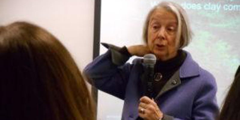 A photo of Lella Gandini, speaking to an audience.