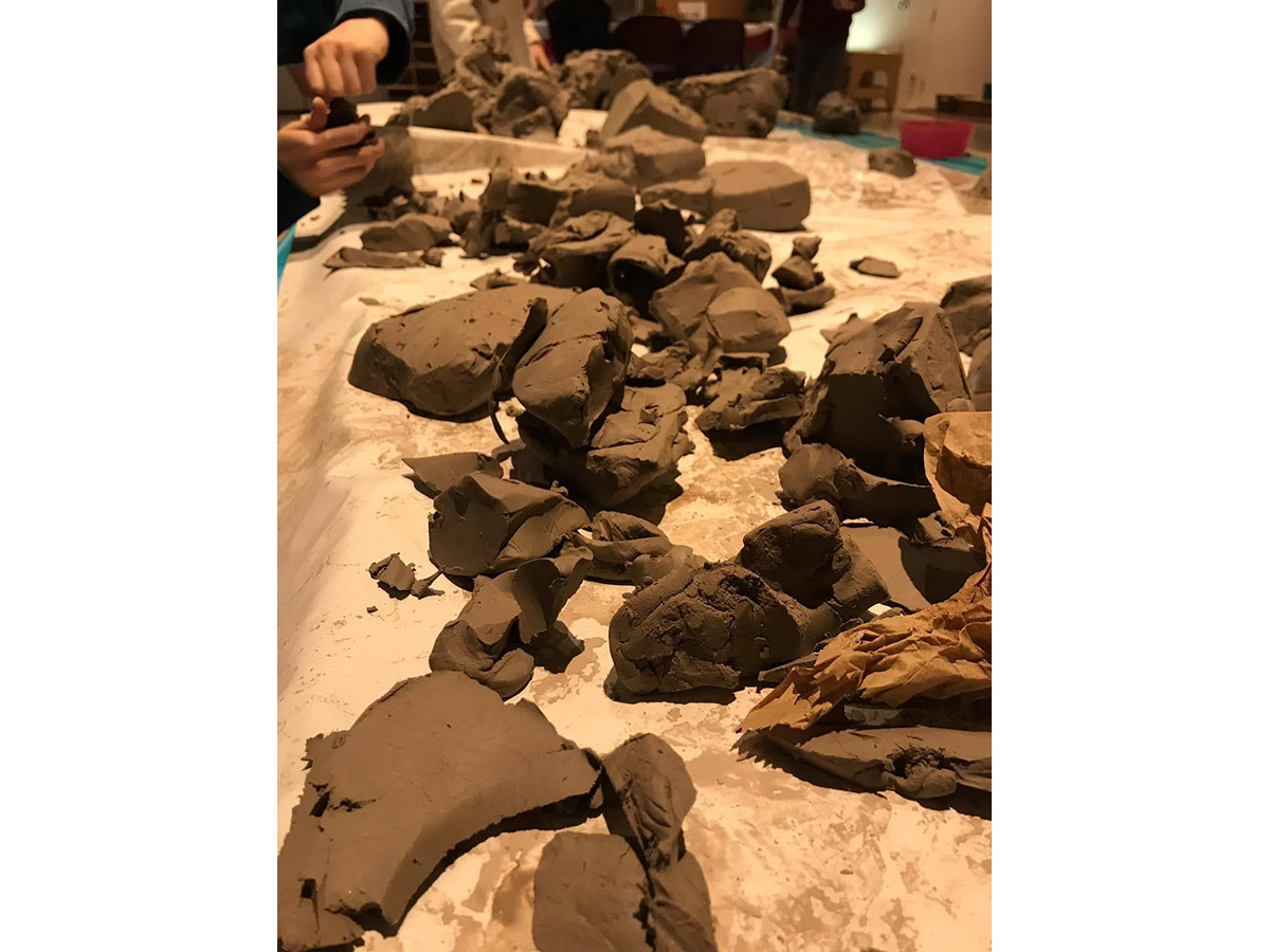 Various chunks and blogs of wet clay.