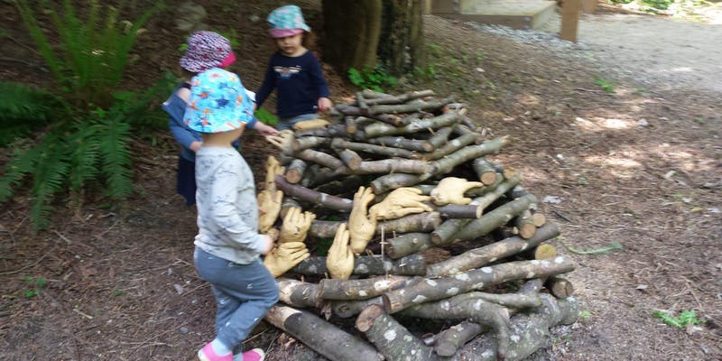 Children Playing outside with wood