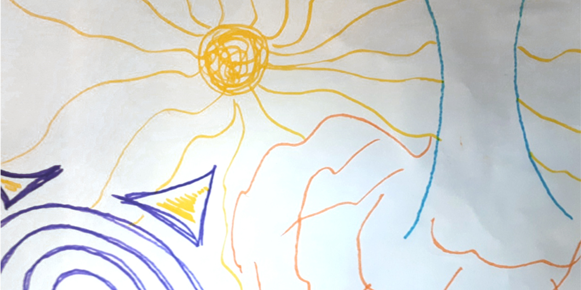 a drawing of a sun on white paper