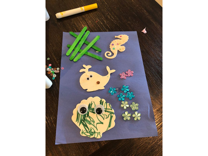 a collage of wooden seashell shapes and flowers and popsicle sticks