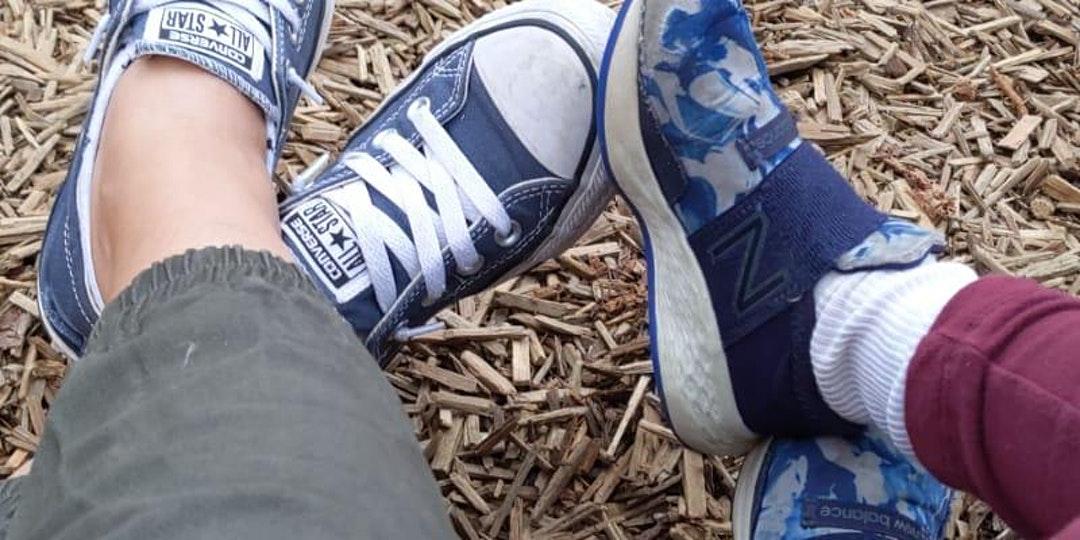 A photo of kids' feet in sneakers
