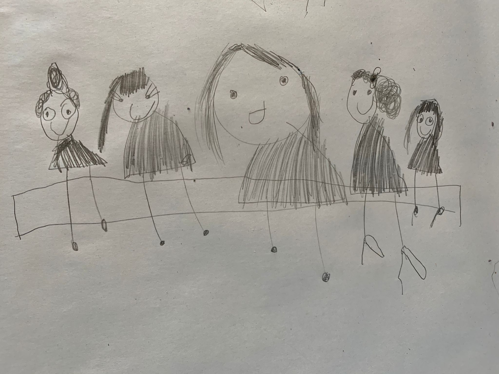 a child's pencil drawing of five people